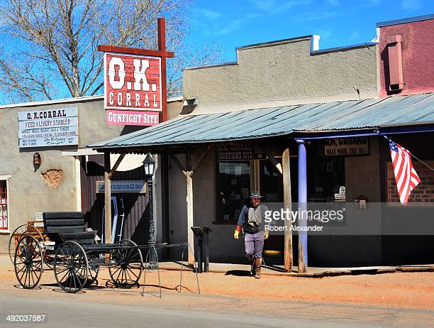 Cowboy leaves the recreated O.K. Corral gunfight site in historic Tombstone, Arizona, known as 'The Town Too Tough to Die.' The town, featuring...