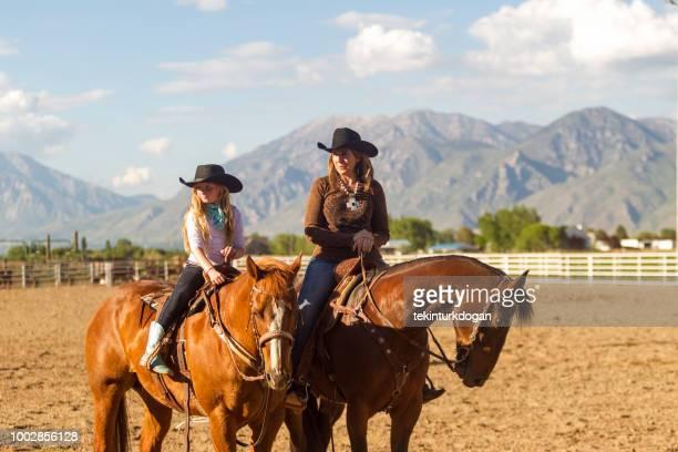 cowboy mother and daughter riding horse at santaquin salt lake city slc utah usa - spanish fork utah stock pictures, royalty-free photos & images