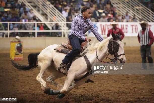 A cowboy participates in the relay race competition at the Bill Pickett Invitational Rodeo on April 1 2017 in Memphis Tennessee The Bill Pickett...