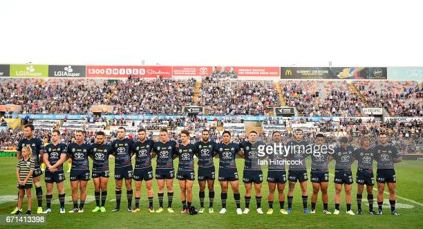 Cowboy players stand in a line for the playing of the 'Last Post' before the start of the round eight NRL match between the North Queensland Cowboys...