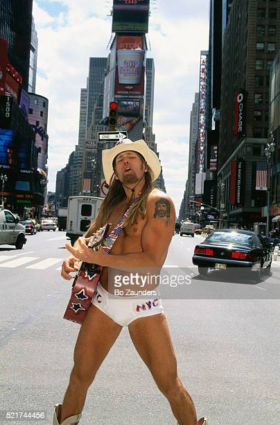 Cowboy Playing a Guitar in His Underwear