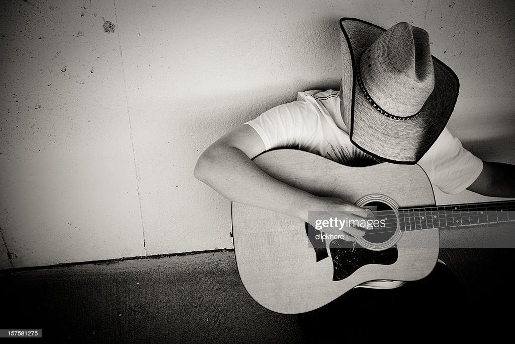 Cowboy playing Guitar : Stock Photo