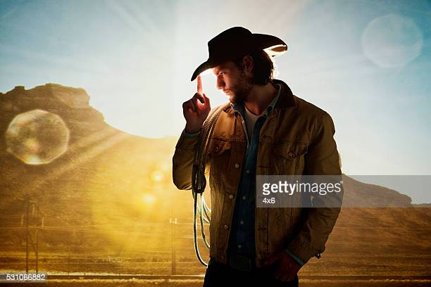 cowboy posing - cowboy hat stock pictures, royalty-free photos & images