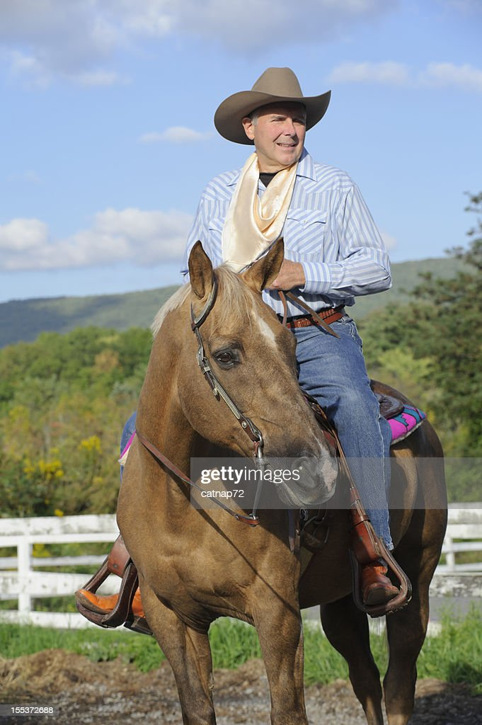 Cowboy Rancher On Palomino Horse Summer Mountain Background High Res Stock Photo Getty Images
