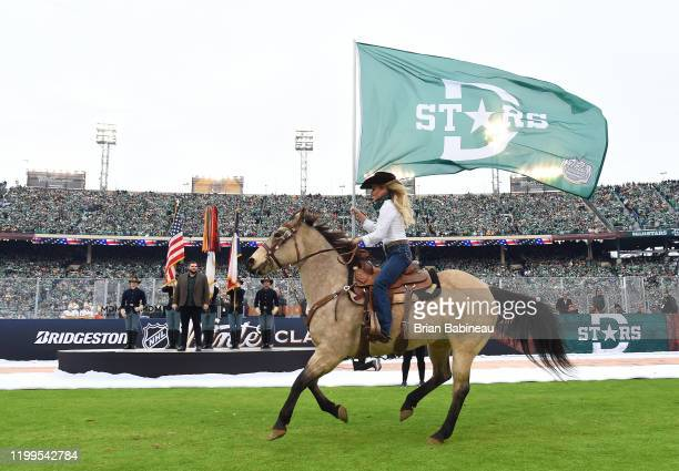 A cowboy rides with a Dallas Stars flag prior to the 2020 NHL Winter Classic between the Nashville Predators and the Dallas Stars at Cotton Bowl on...