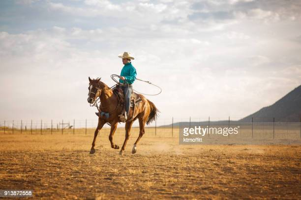 cowboy riding and roping in the early morning on a utah ranch - cowboy stock pictures, royalty-free photos & images