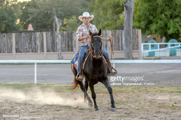 Cowboy Riding Horse At Ranch