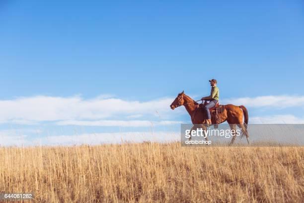 Cowboy Riding Horseback