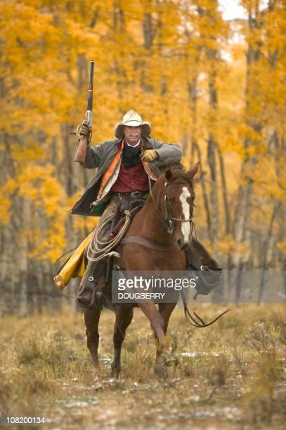 Cowboy riding in fall
