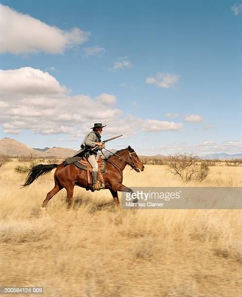 Cowboy riding on horse