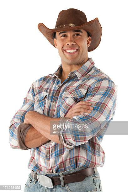 cowboy standing with his arms crossed - cowboy hat stock pictures, royalty-free photos & images