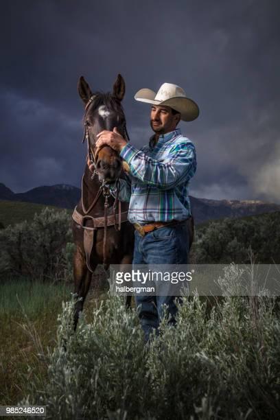 Cowboy Stroking Horse's Nose