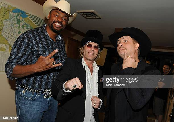 Cowboy Troy Big Kenny and John Rich of Big and Rich backstage at Country Thunder Day 1 on July 19 2012 in Twin Lakes Wisconsin