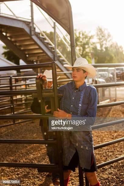 cowboy waiting for rodeo at paddock