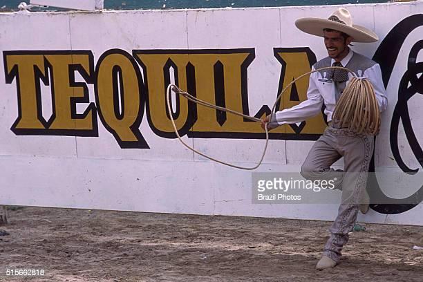 Cowboy wearing sombrero at Charreria Instalacción de Charros de Jalisco Guadalajara Mexico Sombrero widebrimmed hat popularly worn in Mexico used to...