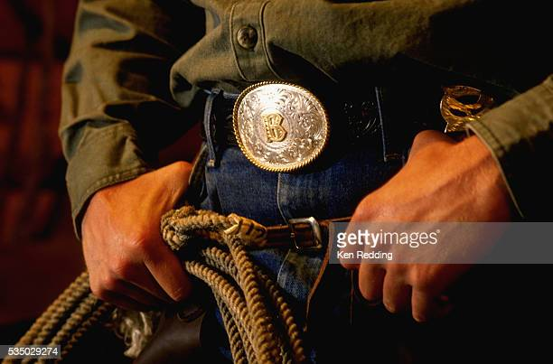 Cowboy With B Belt Buckle and Rope