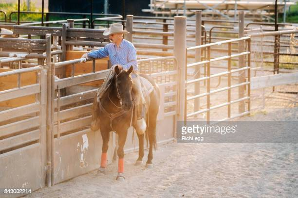 cowboy with his horse - rich_legg stock photos and pictures