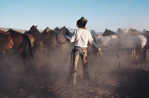 Cowboy with whip in coral, rear view