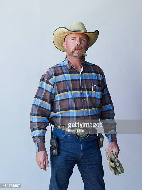 cowboy worker handlebar moustache - cowboy hat stock pictures, royalty-free photos & images