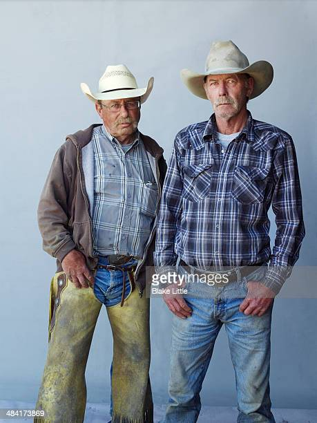 2 - cowboy workers - cowboy stock pictures, royalty-free photos & images