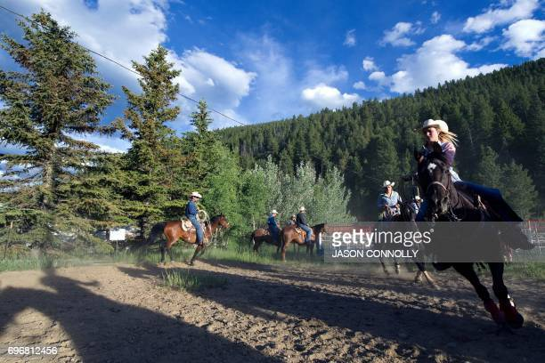 Cowboys and cowgirls warm up their horses before the start of the Oh My Gawd Rodeo at Gene Kiefer Memorial Fairgrounds in Dumont Colorado on June 16...