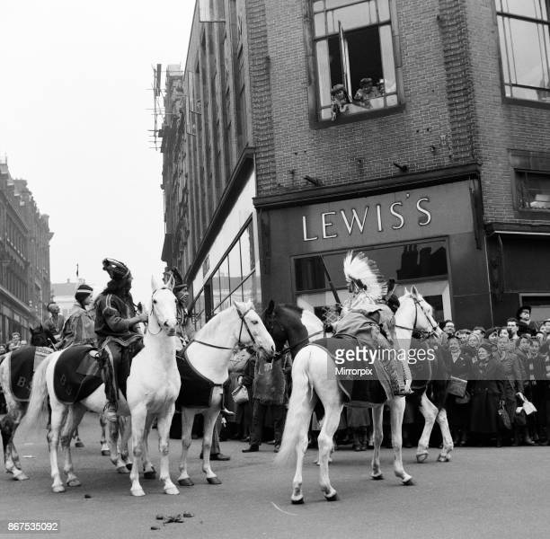 Cowboys and Indians from Billy Smarts Circus ride into town and stage a running fight outside the local store, Lewis's. Davy Crocket Smart fights off...