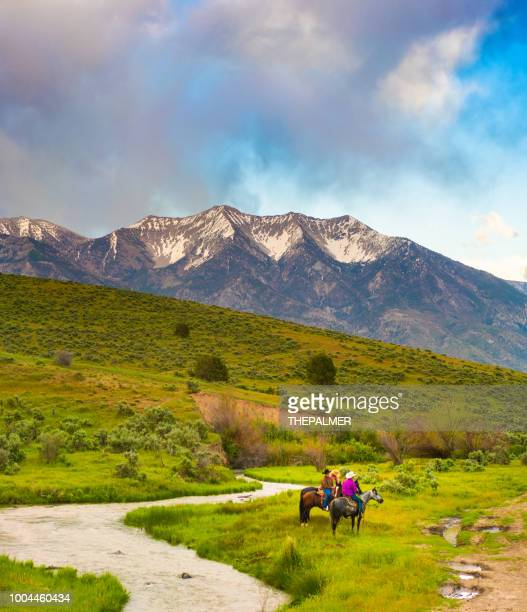 cowboys and utah mountain range - spanish fork utah stock pictures, royalty-free photos & images