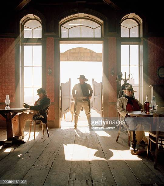 cowboys at saloon - wild west stock pictures, royalty-free photos & images