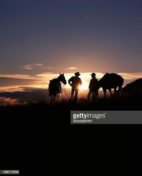 Cowboys bei Sonnenuntergang