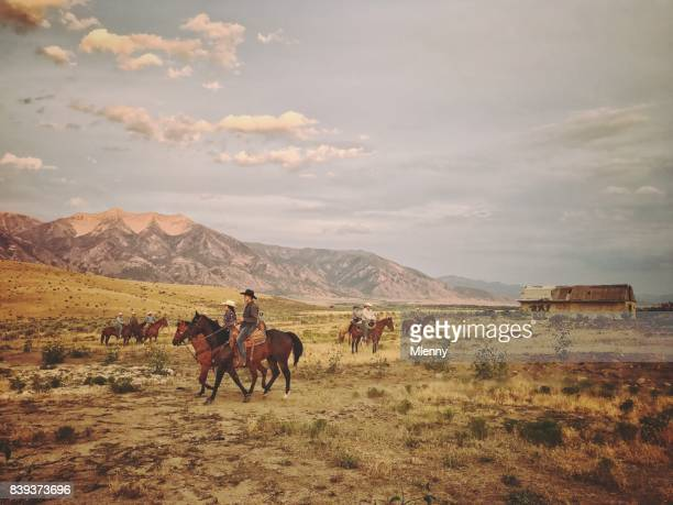 cowboys bringing back horses at dusk - ranch stock pictures, royalty-free photos & images
