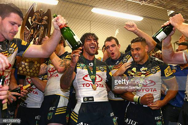 Cowboys captain Johnathan Thurston and team mates sing their team song in the Cowboys changeroom after winning the 2015 NRL Grand Final match between...