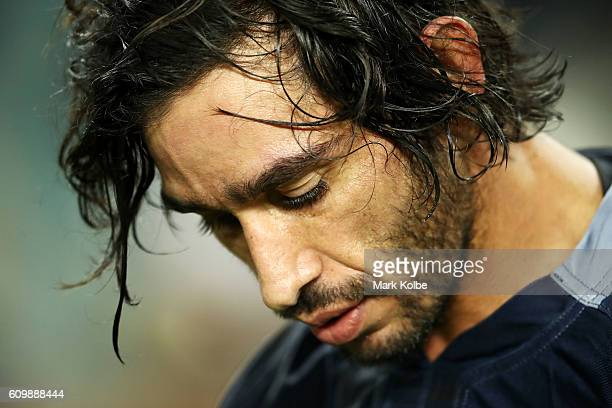Cowboys captain Johnathan Thurston looks dejected after losing the NRL Preliminary Final match between the Cronulla Sharks and the North Queensland...