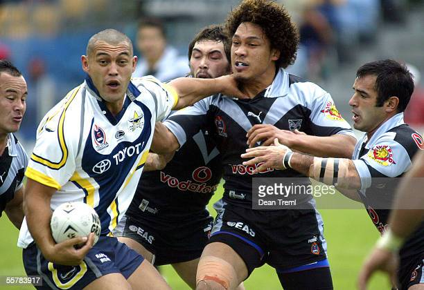 Cowboys captain Paul Rauhihi looks to unload while under pressure from Monty Betham Wairangi Koopu Clinton Toopi and Stacey Jones of the Warriors...