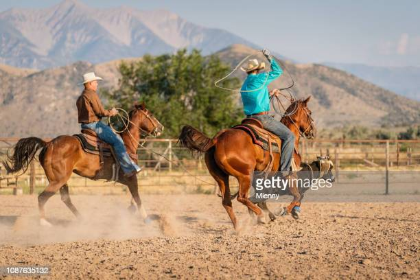 cowboys chasing bull rodeo riding action - spanish fork utah stock pictures, royalty-free photos & images
