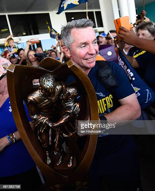 Cowboys coach Paul Green holds the NRL trophy after arriving back at the Townsville airport before heading out to the North Queensland Cowboys NRL...