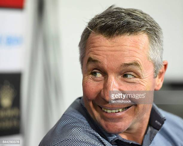 Cowboys coach Paul Green smiles at the post match media conference at the end of during the round 17 NRL match between the South Sydney Rabbitohs and...