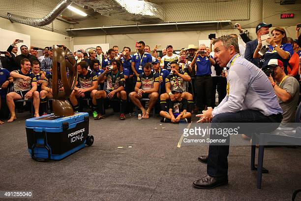 Cowboys coach Paul Green talks to his players in the Cowboys changeroom after winning the 2015 NRL Grand Final match between the Brisbane Broncos and...