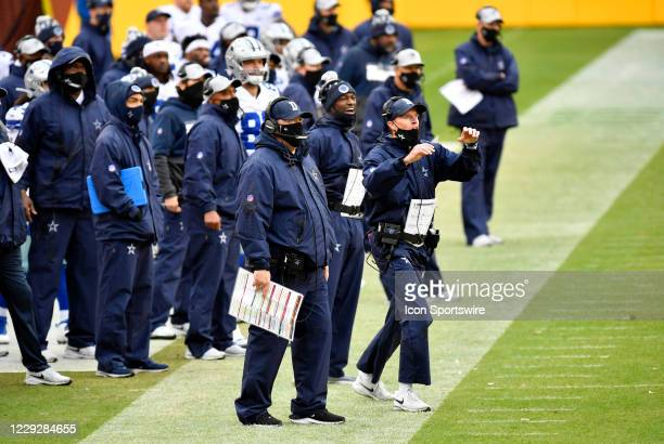 Cowboys head coach Mike McCarthy and other assistant coaches watch from the sideline during the Dallas Cowboys vs. Washington Football Team NFL game...