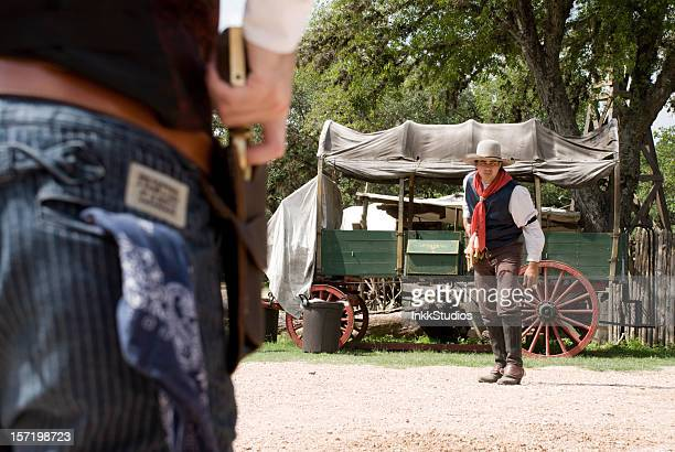 cowboys in a gun fight - cowboy stock photos and pictures