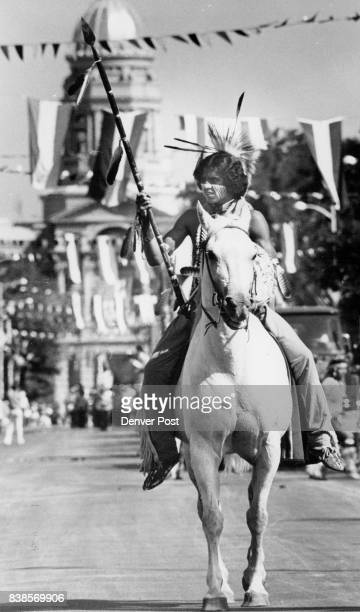 Cowboys Indians Do Their Things at Frontier Days Morgan Tosee a Comanche Indian from Sterling Okla rides his pony with lance at the ready while above...