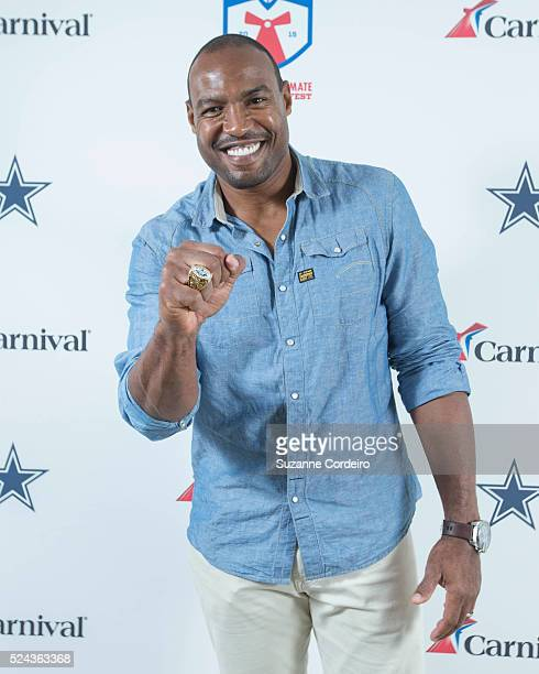 Cowboys legend Darren Woodson pose on the red carpet at Carnival's Ultimate Cowboys Fan Fest on October 18 2015 at Klyde Warren Park in Dallas Texas...