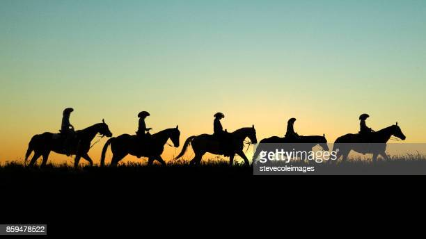cowboys on horseback at sunset - appaloosa stock pictures, royalty-free photos & images