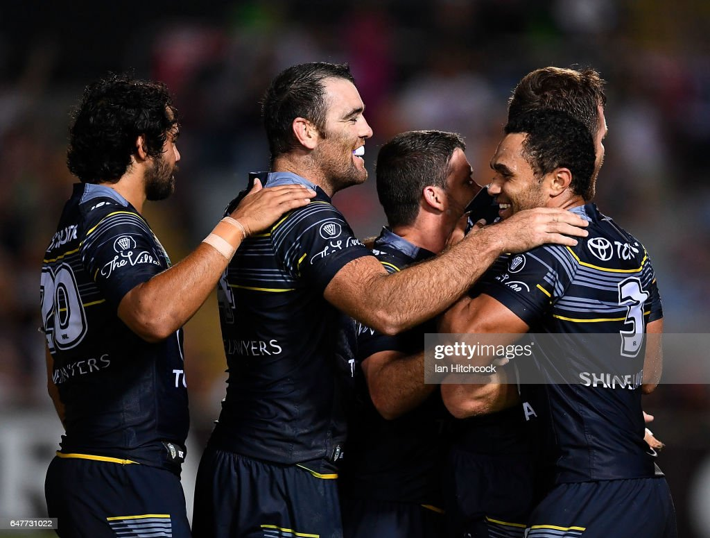 Cowboys players celebrate after Gavin Cooper's game winning try during the round one NRL match between the North Queensland Cowboys and the Canberra Raiders at 1300SMILES Stadium on March 4, 2017 in Townsville, Australia.