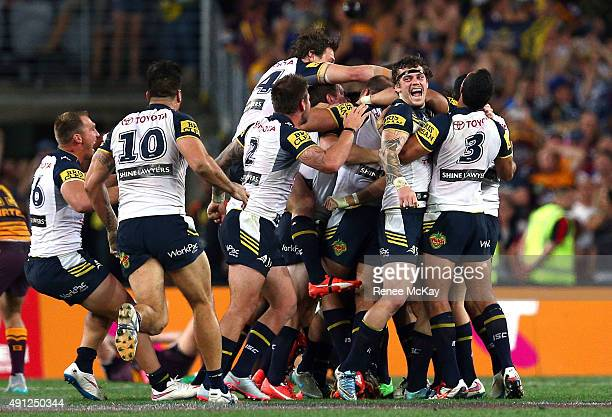 Cowboys players celebrate after Johnathan Thurston kicks the winning field goal in golden point time during the 2015 NRL Grand Final match between...