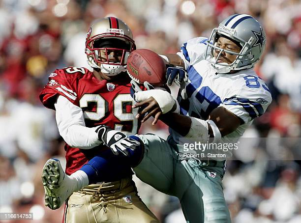 Cowboys receiver Terry Glenn and 49ers cornerback Ahmed Plummer fight over a ball in the second half as the Dallas Cowboys defeated the San Francisco...