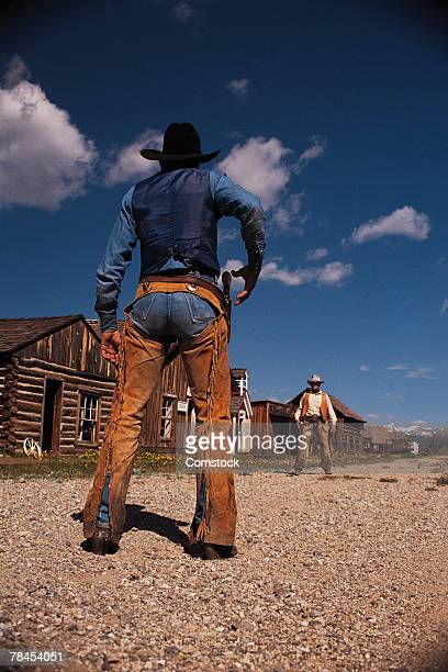 cowboys re-enacting gunfight in south park city - confrontation stock pictures, royalty-free photos & images