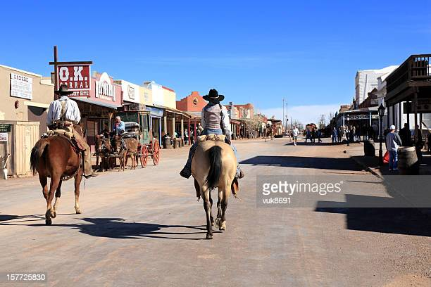 cowboys ride into tombstone - tombstone stock pictures, royalty-free photos & images