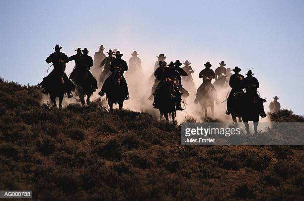 cowboys riding horses, silhouette - cowboy stock pictures, royalty-free photos & images