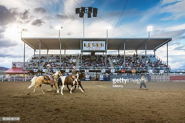 Cowboys riding into Rodeo Arena Cody Stampede Wyoming