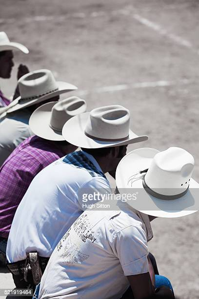 cowboys sitting together at rodeo - hugh sitton stock pictures, royalty-free photos & images